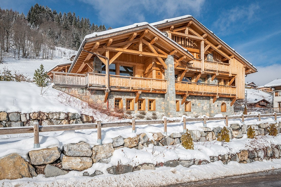 Outside view of Abachi luxury chalet in Les Gets with snow