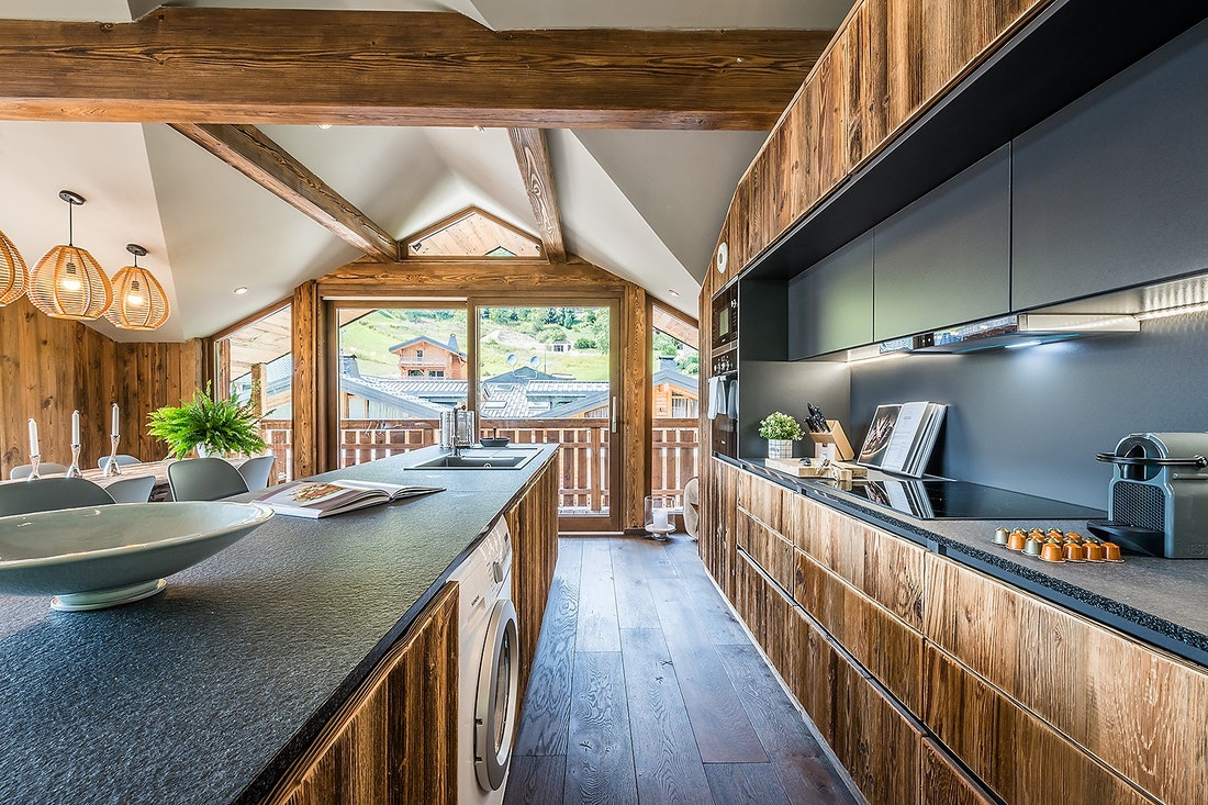 Open kitchen with washing machine at Moulin III luxury chalet in Les Gets