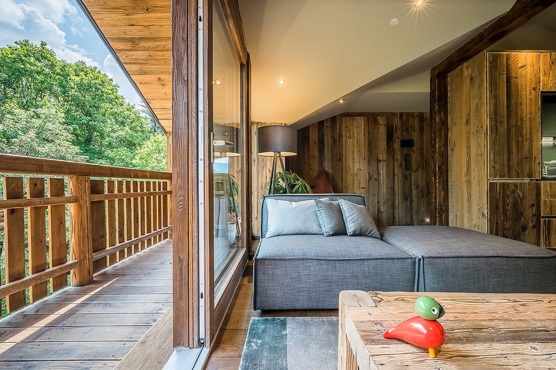 Wooden terrace with forest view of Moulin II luxury chalet in Les Gets