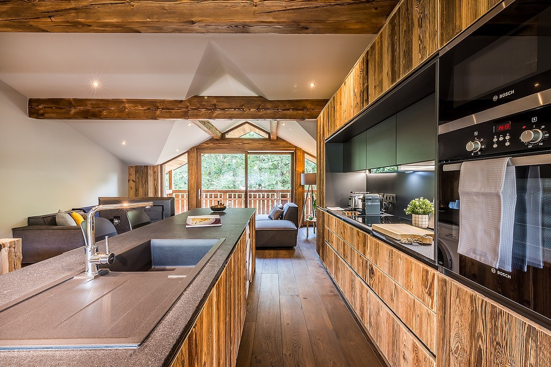 Black and wood open kitchen of Moulin II luxury chalet in Les Gets
