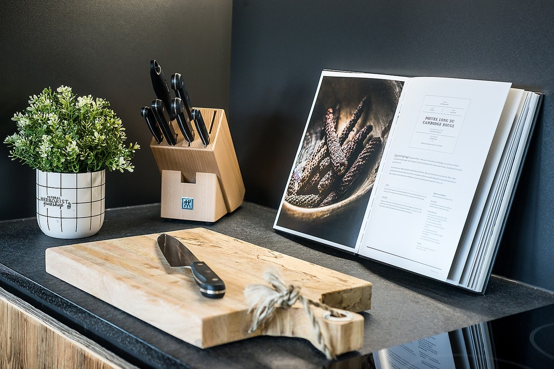 Wooden chopping board with black knives