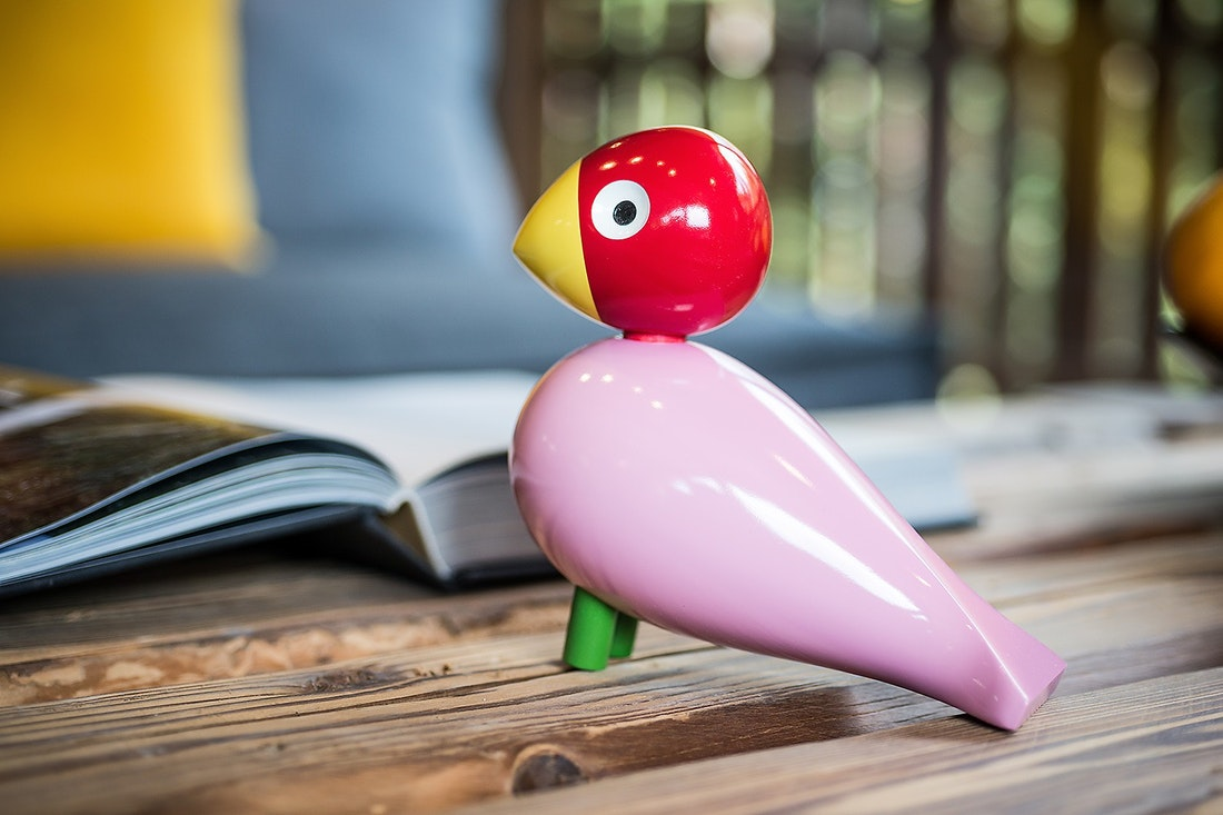 Iconic red and pink wooden songbird by Kay Bojesen