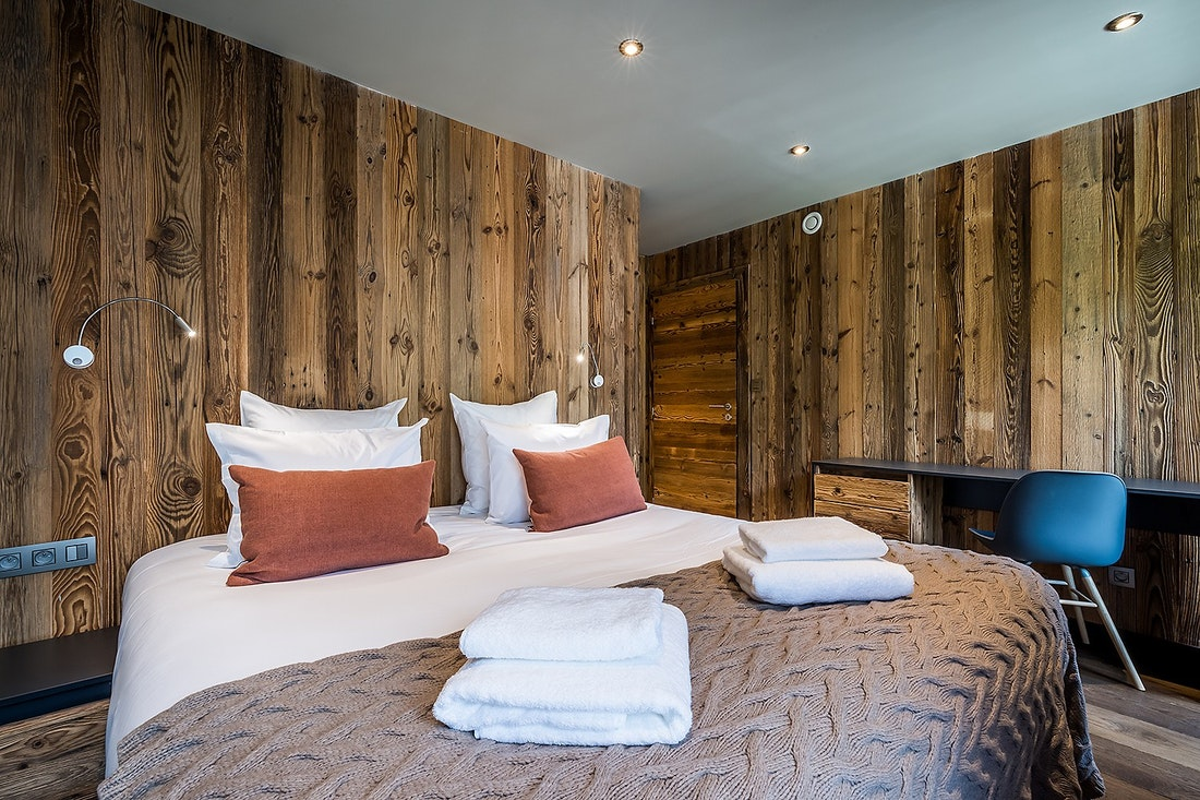 Cosy wooden double bedroom at Moulin II luxury chalet in Les Gets