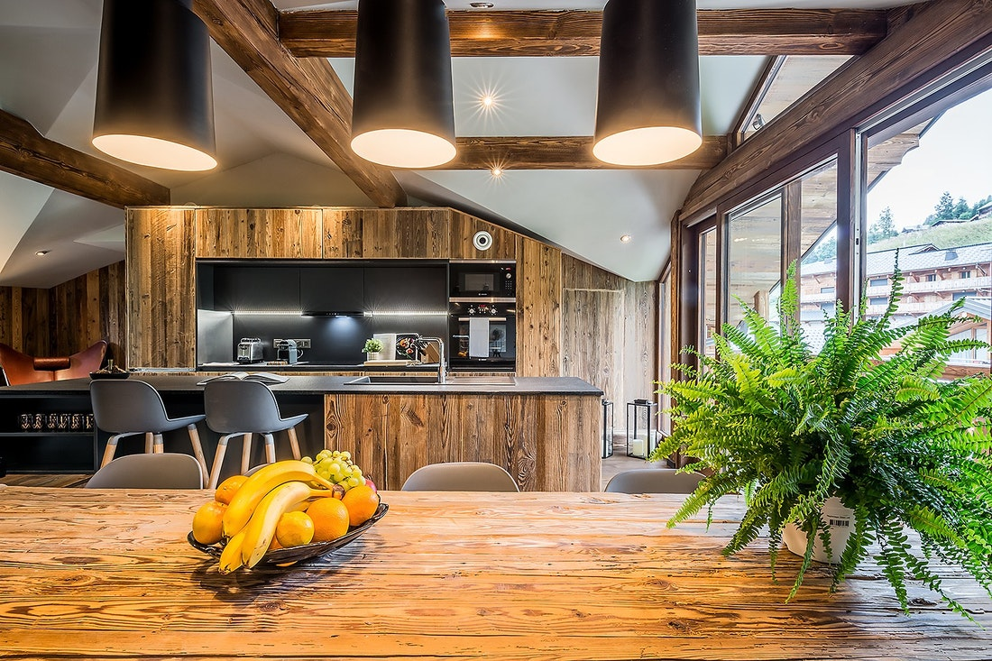 Modern black and wooden open kitchen
