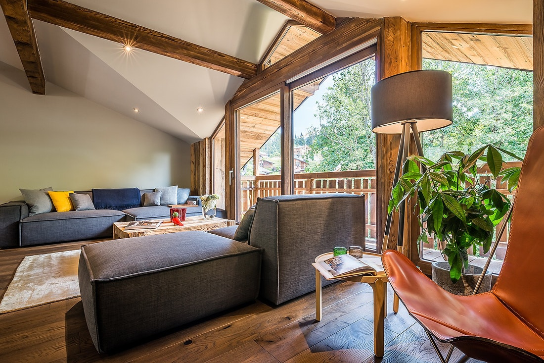 Large living room with two grey couches at Moulin II luxury chalet in Les Gets