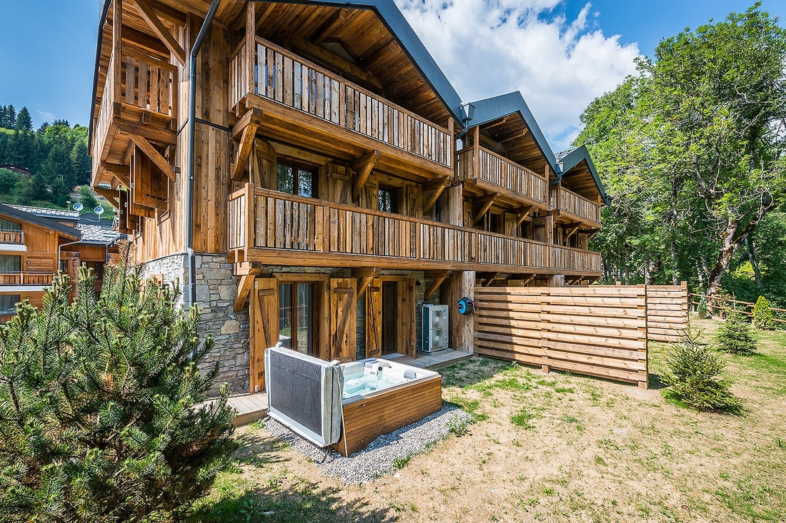 Outside view of Moulin II luxury chalet with hot tub in Les Gets