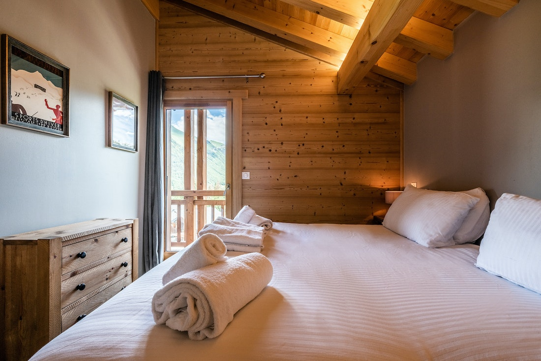 Double ensuite bedroom with balcony overlooking the French Alps at Balata luxury chalet in Morzine