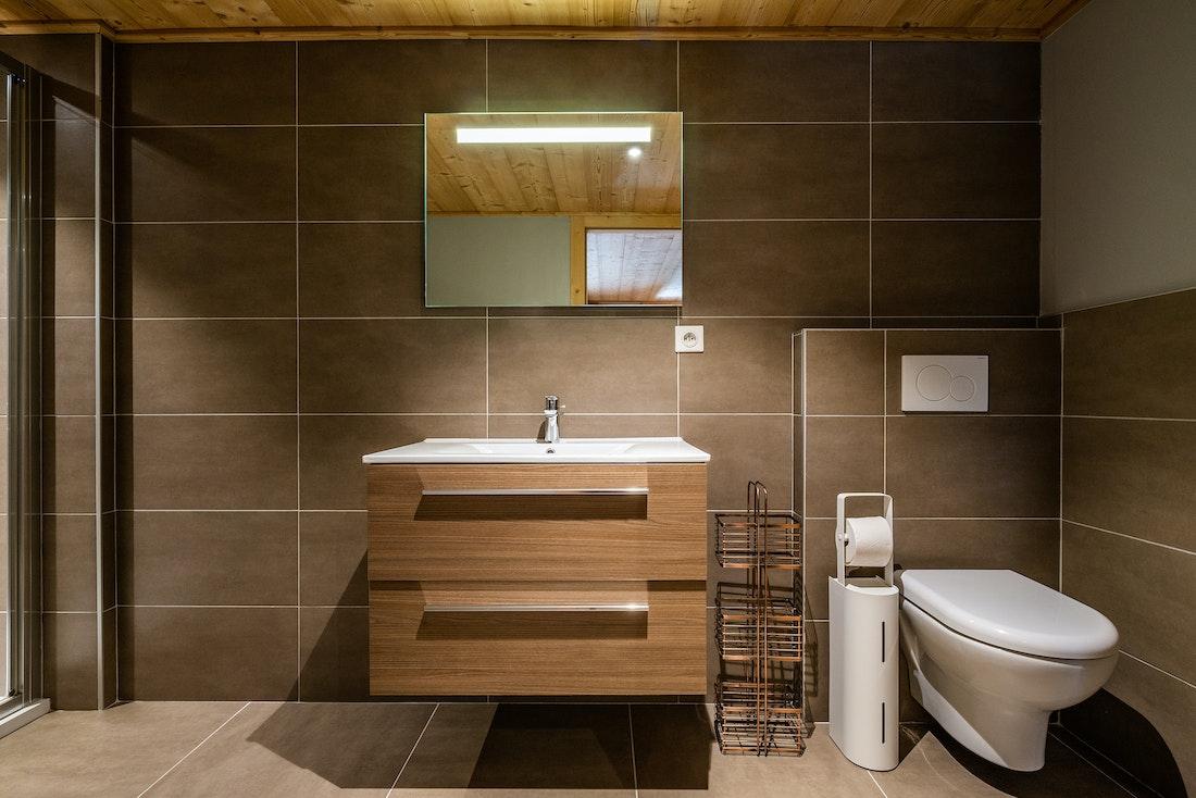 Modern bathroom with wooden sink at Balata luxury chalet in Morzine