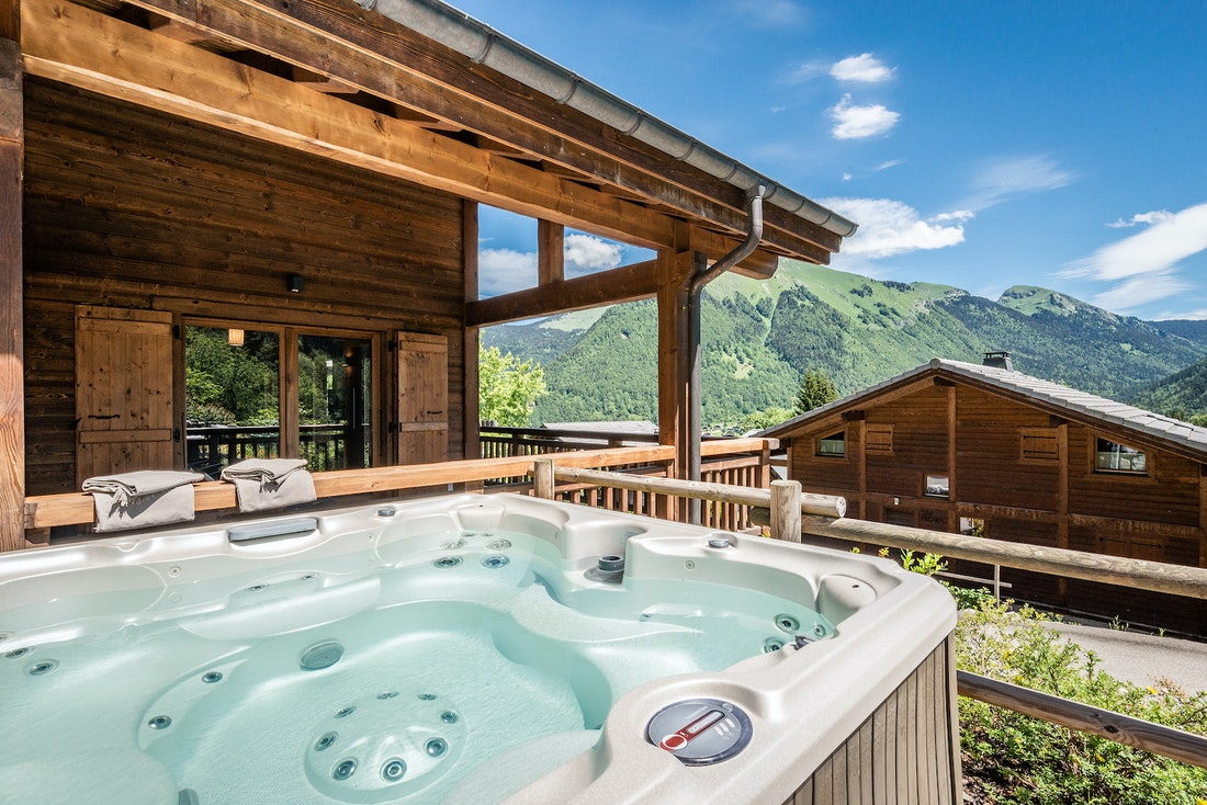 Outdoor hot tub on the terrace of Balata luxury chalet in Morzine