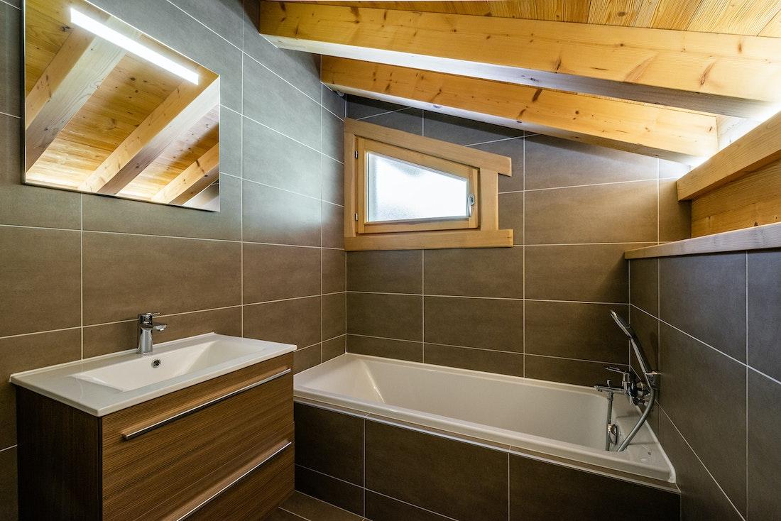 Modern bathroom with bathtub at Balata luxury chalet in Morzine