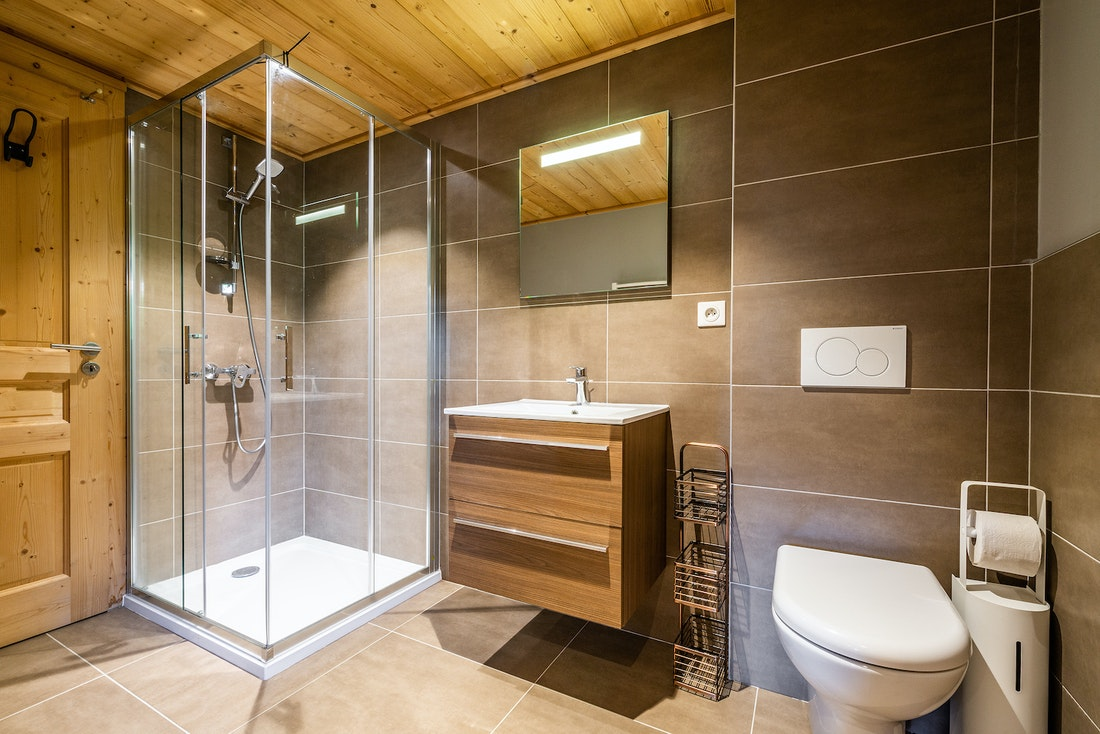 Modern bathroom with shower and toilet at Balata luxury chalet in Morzine