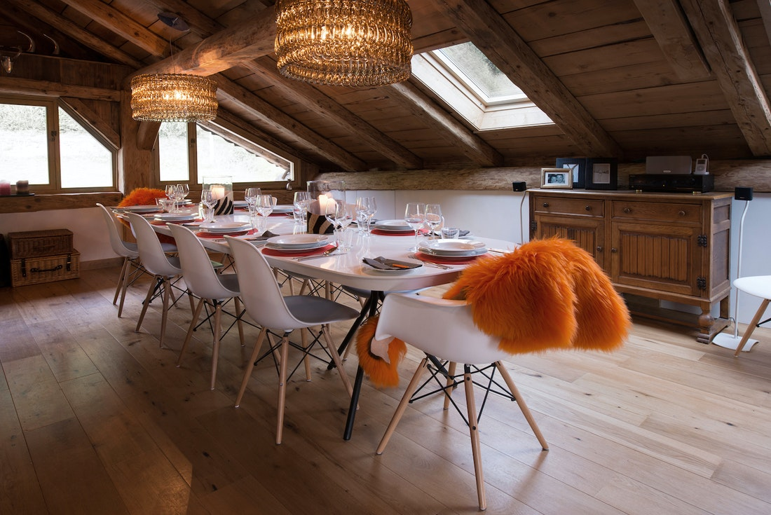 Cosy dining room with wooden ceiling at La Ferme de Margot luxury chalet in Morzine
