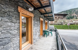 Terrace with coffee table and chairs at Ourson accommodation in Morzine