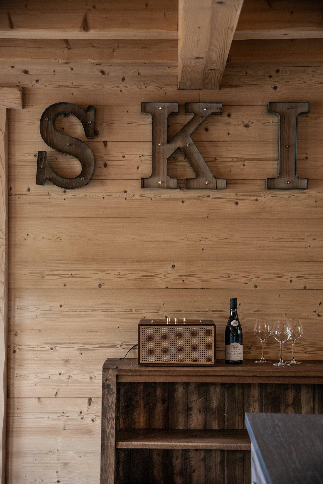 SKI wooden sign in the living room of Balata luxury chalet in Morzine