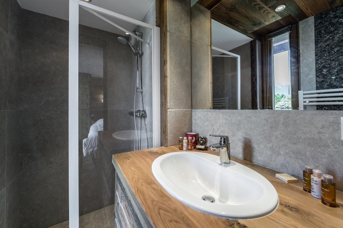 Modern bathroom walk-in shower ski in ski out apartment Moabi Courchevel Le Praz