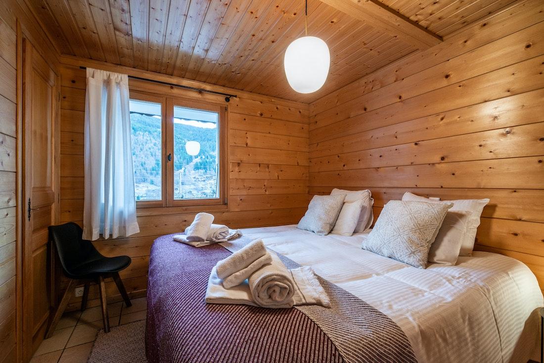 Wooden double bedroom ample cupboard space landscape views eco-friendly chalet Doux-Abri Morzine