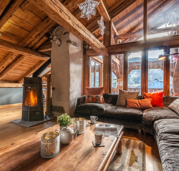 Living room with black fireplace at La Ferme de Margot luxury chalet in Morzine