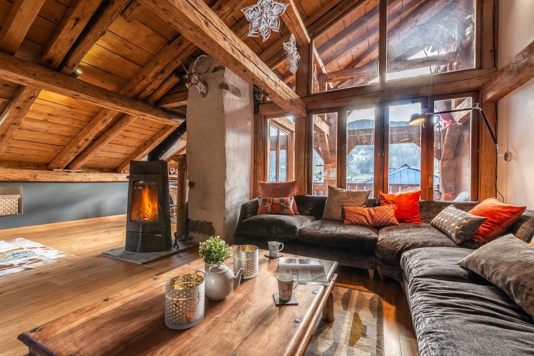 Living room with black fireplace at La Ferme de Margot luxury chalet in Morzine