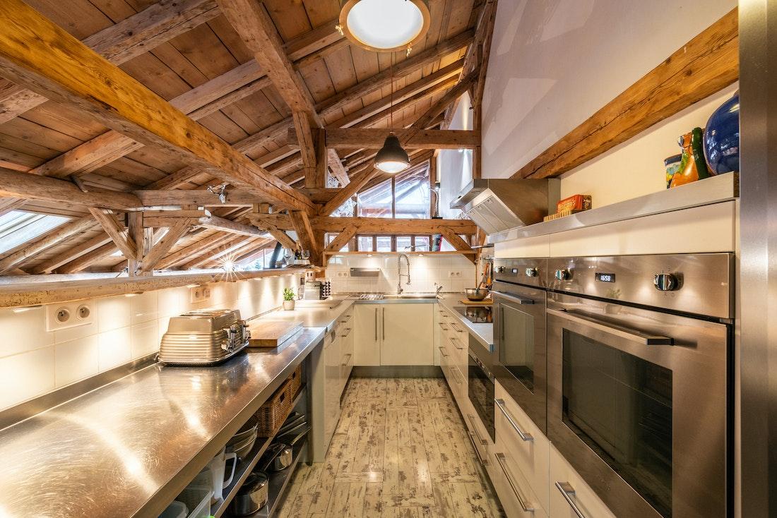 Modern fully-equipped kitchen at La Ferme de Margot luxury chalet in Morzine