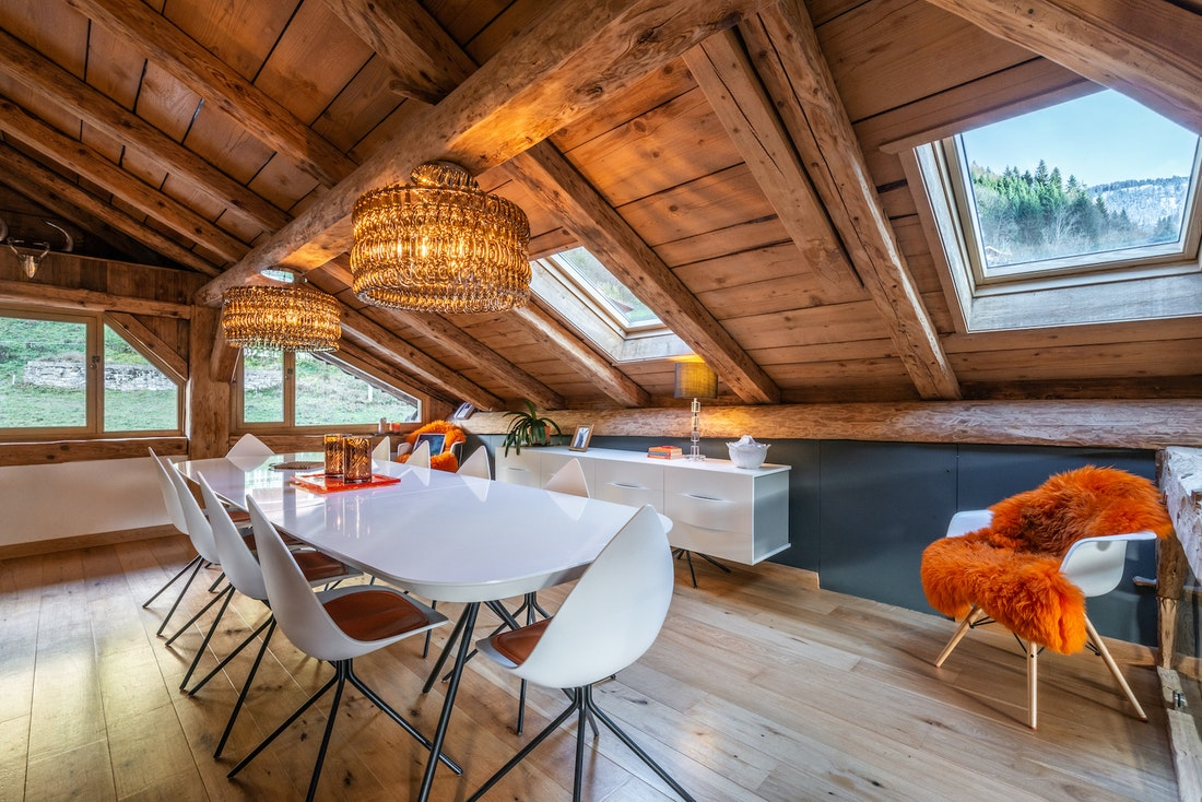 Dining room with wooden ceiling at La Ferme de Margot luxury chalet in Morzine