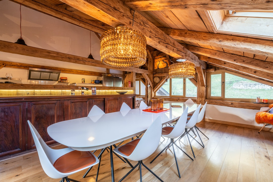 Bright dining room with open kitchen at La Ferme de Margot luxury chalet in Morzine