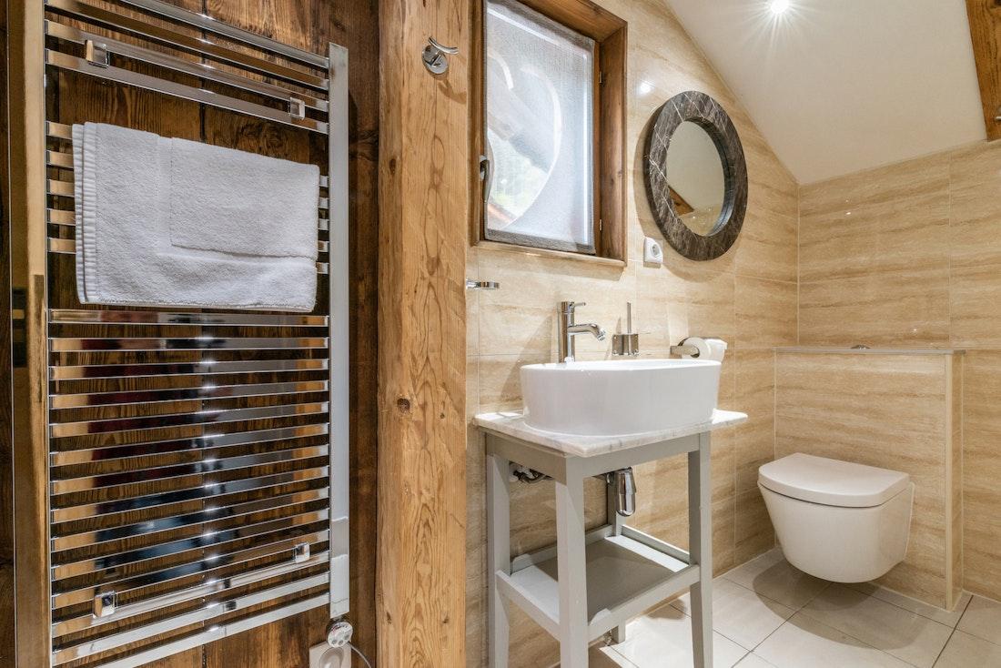 Modern bathroom with towels heater at La Ferme de Margot luxury chalet in Morzine