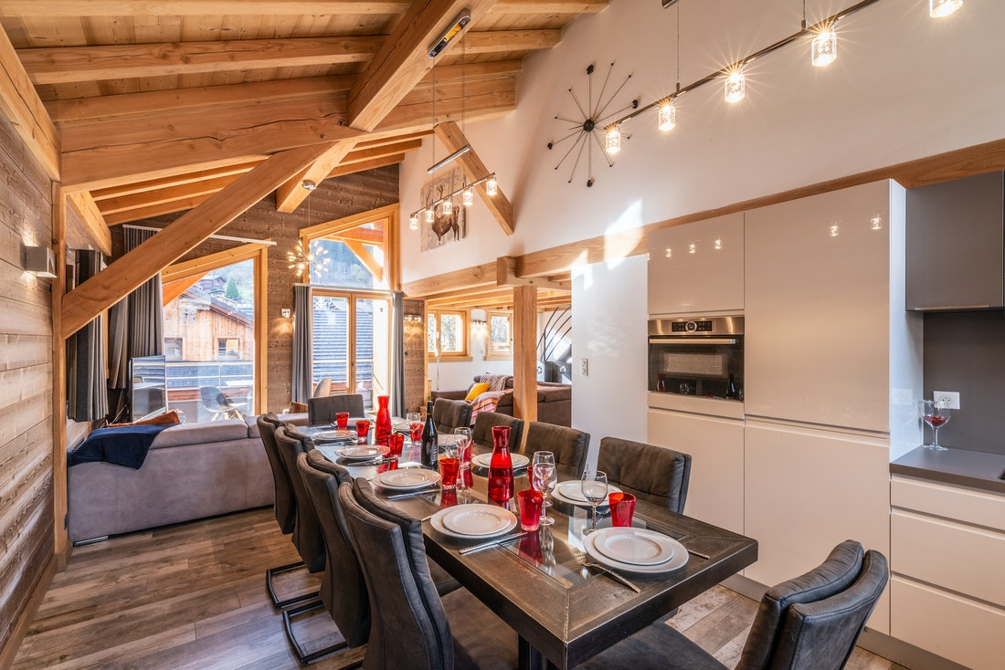 Modern dining room with red and white kitchenware at Etoile accommodation in Morzine