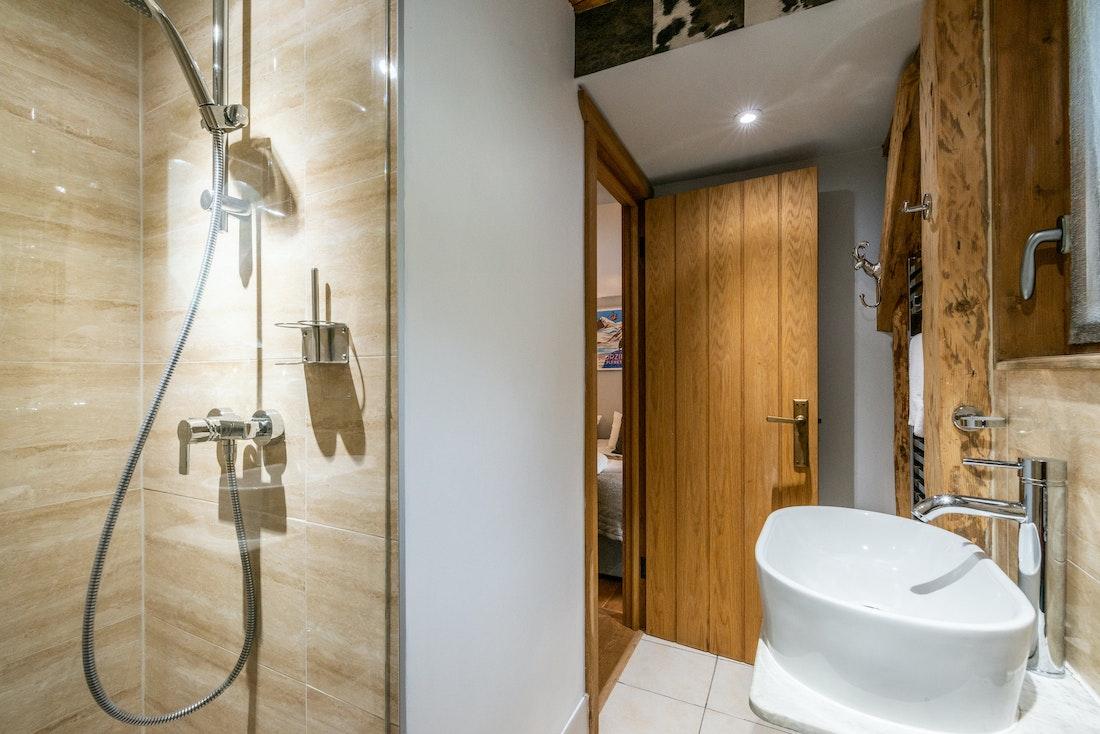 Beige modern shower at La Ferme de Margot luxury chalet in Morzine