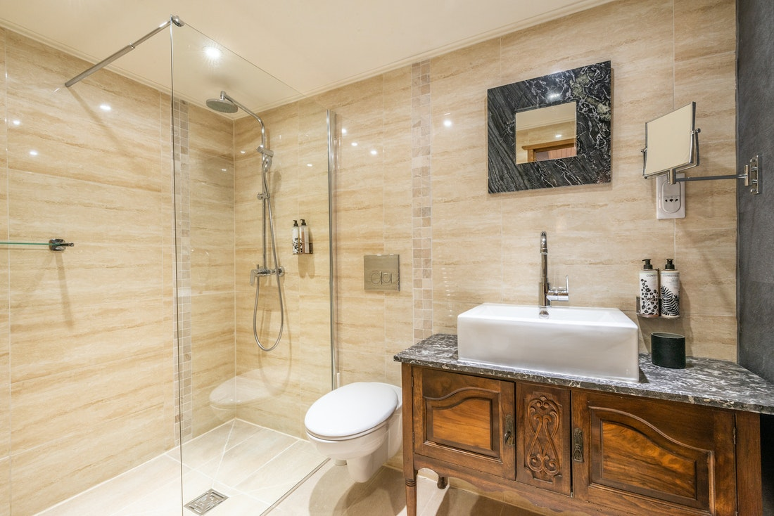 Modern bathroom with shower and toilet at La Ferme de Margot luxury chalet in Morzine