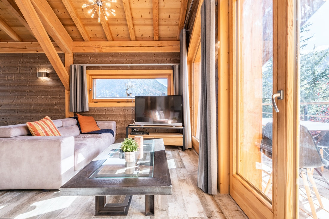 Modern living room with TV and mountain views at Etoile accommodation in Morzine