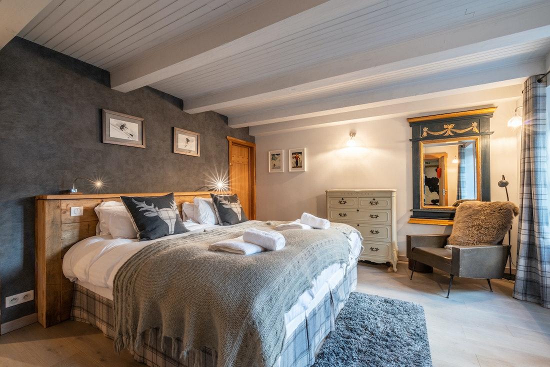 Double bedroom en-suite with fresh towels at La Ferme de Margot luxury chalet in Morzine