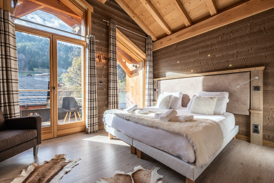 Double bedroom with white faux-fur details at Etoile accommodation in Morzine