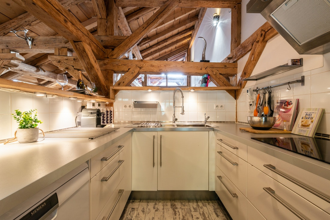 White modern fully-equipped kitchen at La Ferme de Margot luxury chalet in Morzine