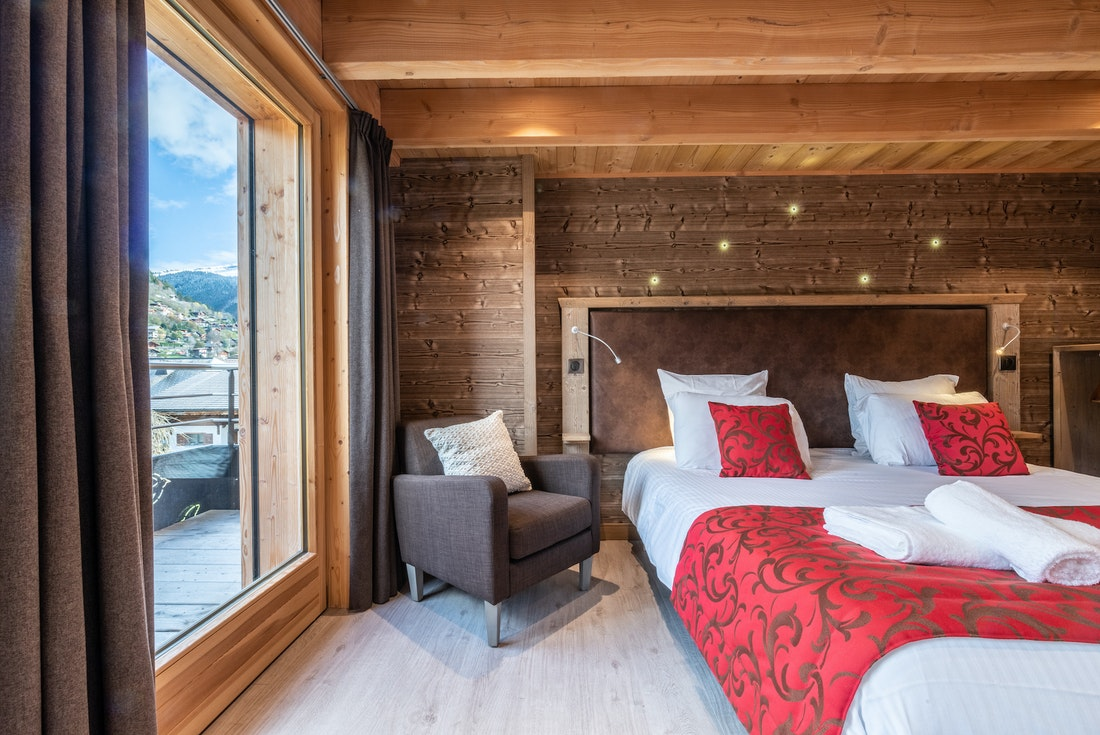 Wooden cosy double bedroom at Etoile accommodation in Morzine