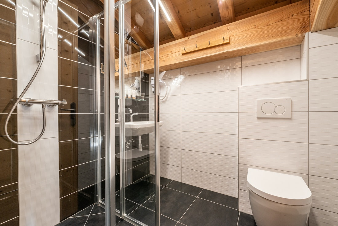 Black and white modern bathroom with shower at Etoile accommodation in Morzine