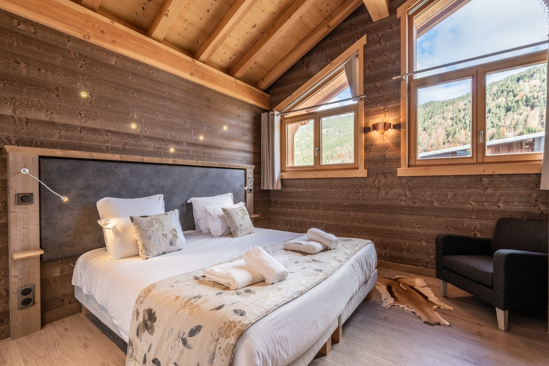 Double bedroom with large windows at Etoile accommodation in Morzine