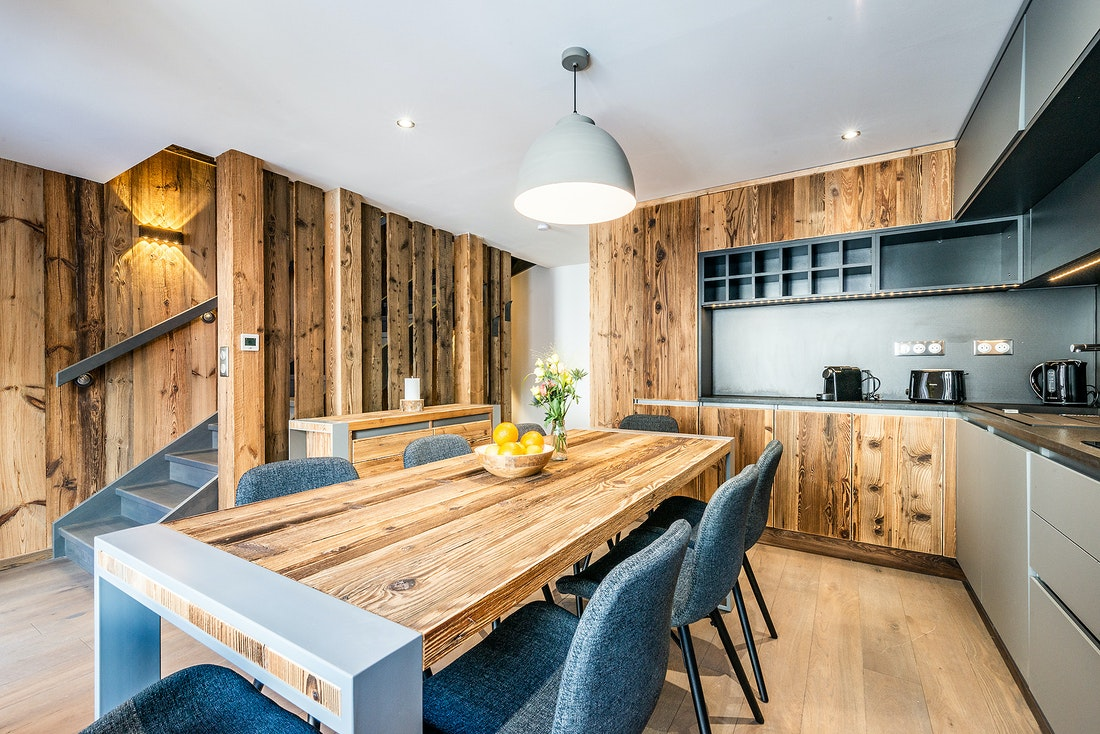 Modern wooden dining room at Douka accommodation in Morzine