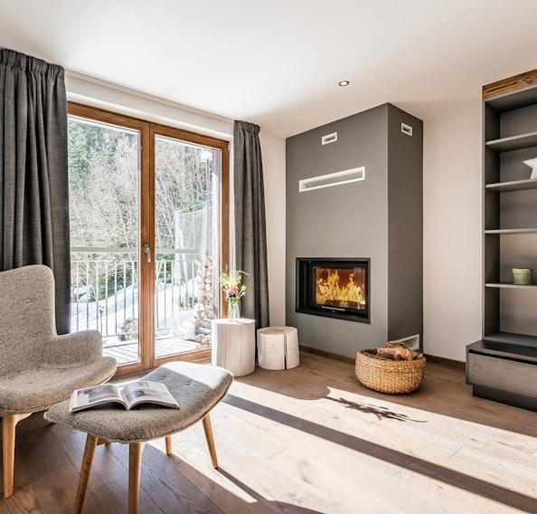 Reading corner and fireplace at Badi luxury chalet in Chamonix