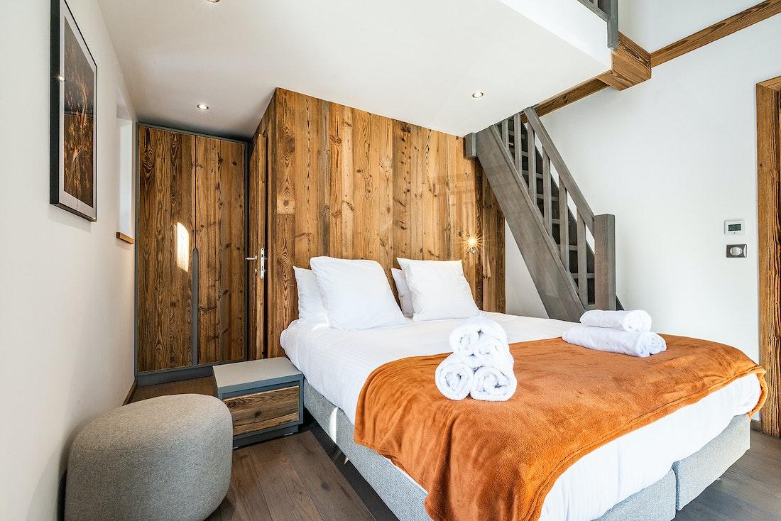 Duplex bedroom with wooden walls at Ravanel luxury accommodation in Chamonix