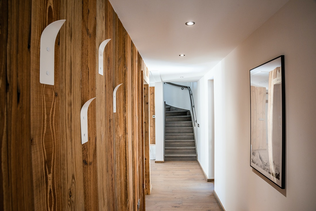 Wooden corridor with coat hangers at Ruby luxury accommodation in Chamonix