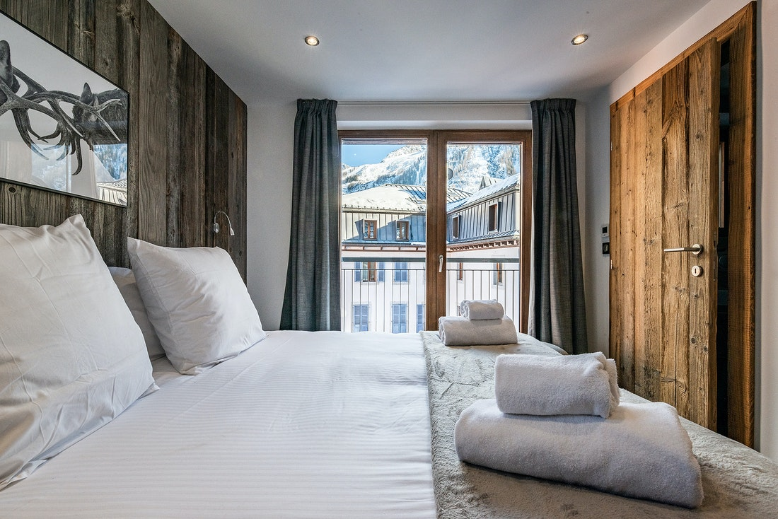 Double bedroom with mountain views at Douka accommodation in Morzine