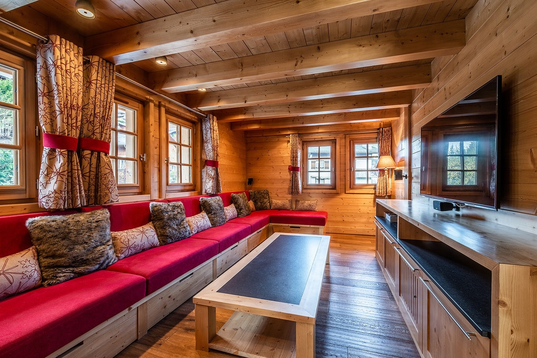 Red tv room of Abachi luxury chalet in Les Gets
