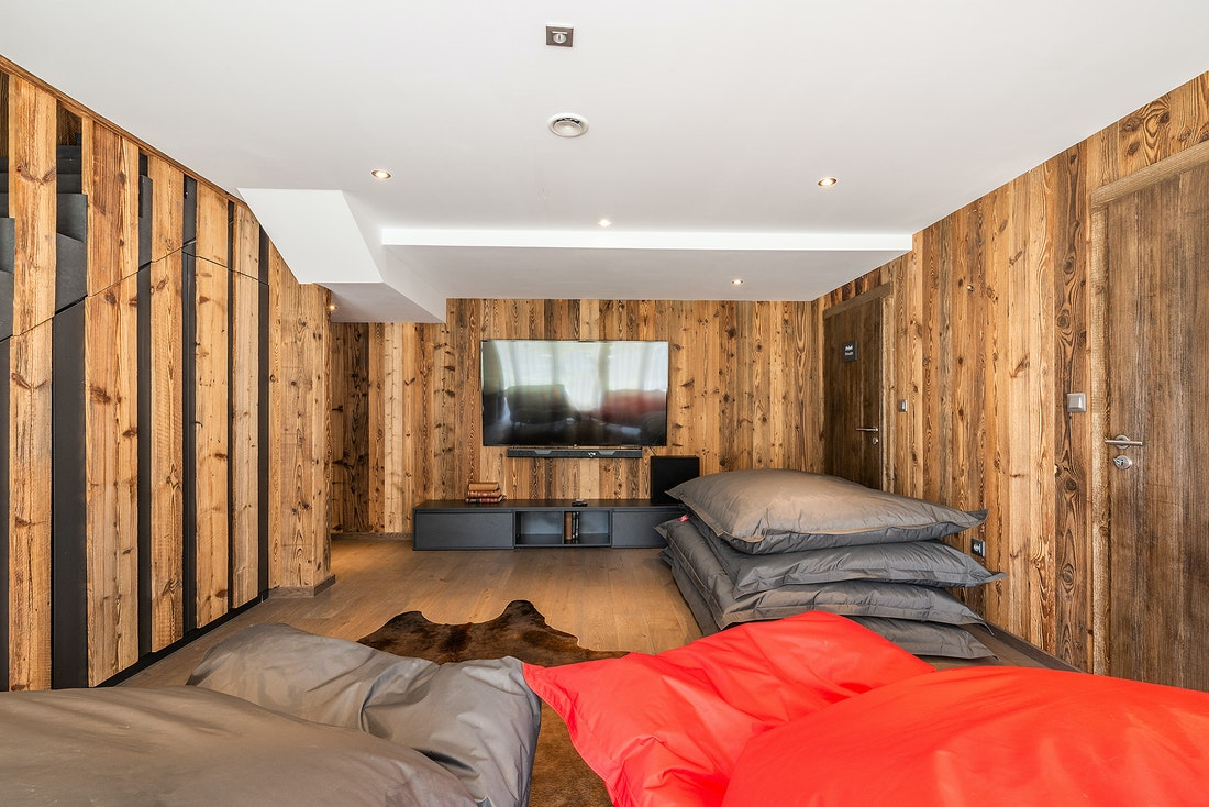 TV room with Fatboy pillows at Le Rouge luxury chalet in Morzine
