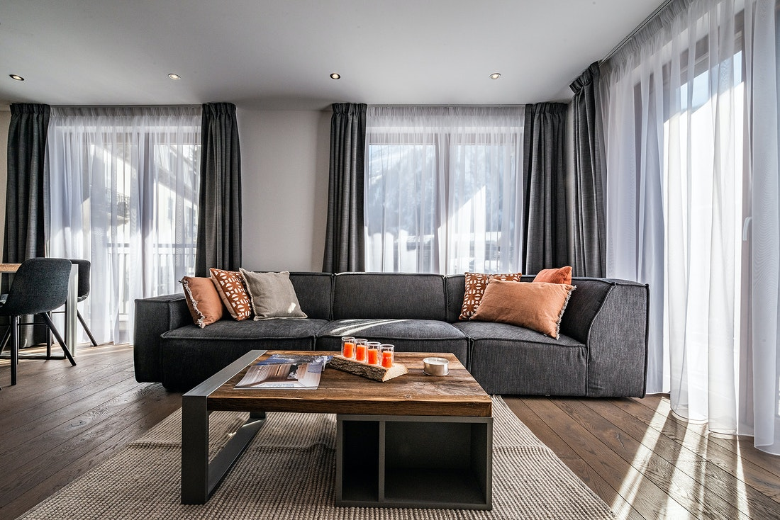 Living room with large couch at Ravanel luxury accommodation in Chamonix