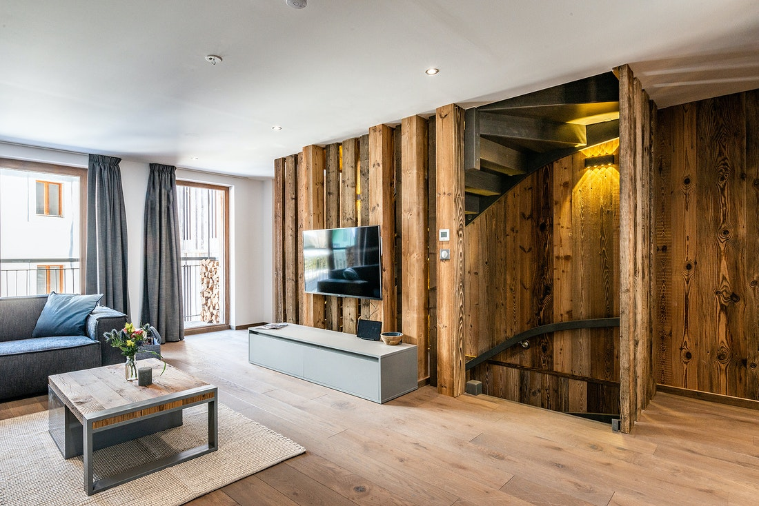 Modern living room with TV at Douka accommodation in Morzine