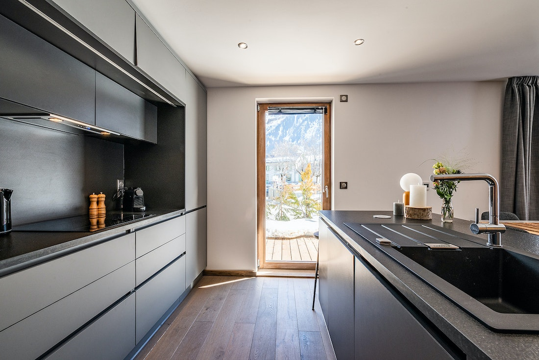 Modern black and wooden kitchen at Eyong accommodation in Chamonix