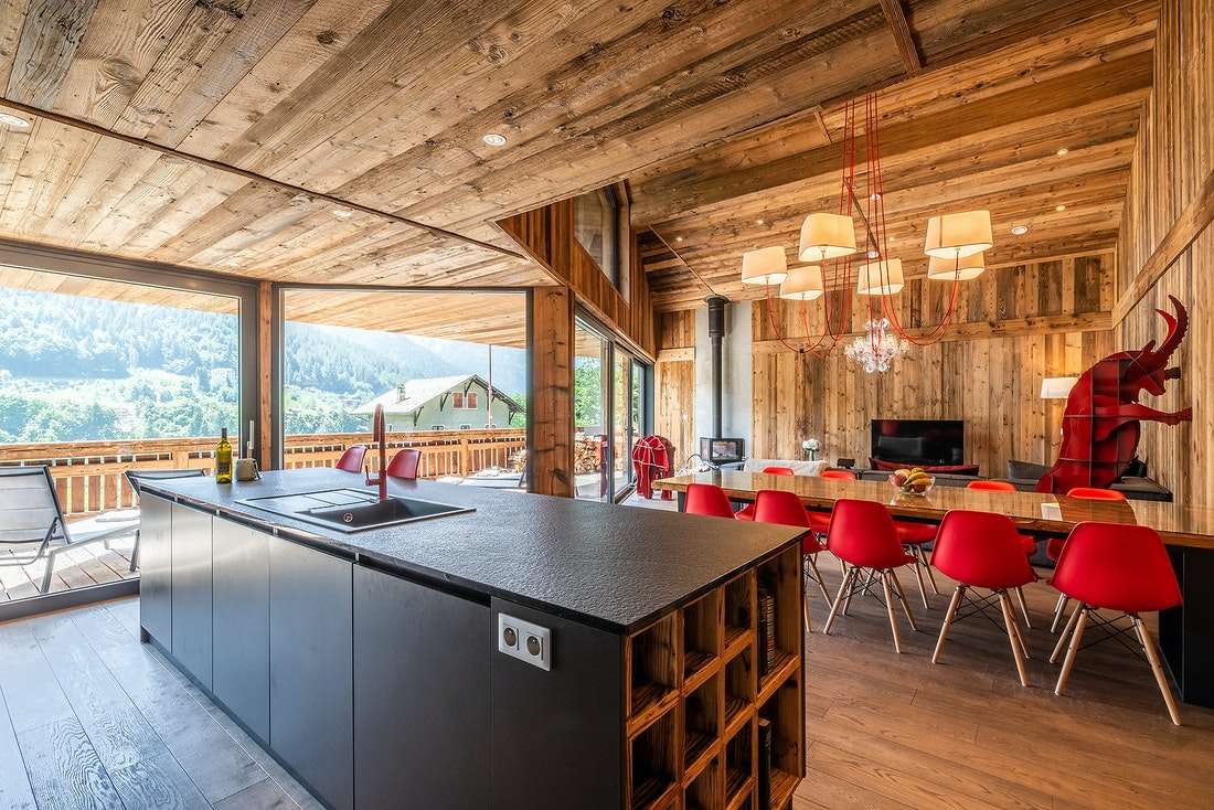 Open kitchen and living room of Le Rouge luxury chalet in Morzine