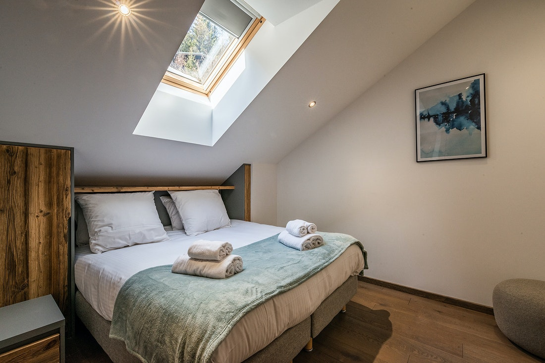 Double bedroom with fresh towels at Herzog luxury chalet in Chamonix