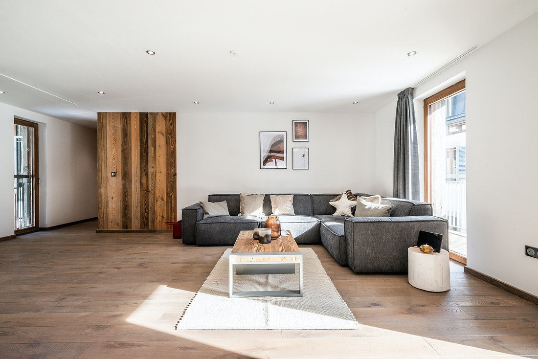 Modern living room with wooden panel at Ruby luxury accommodation in Chamonix