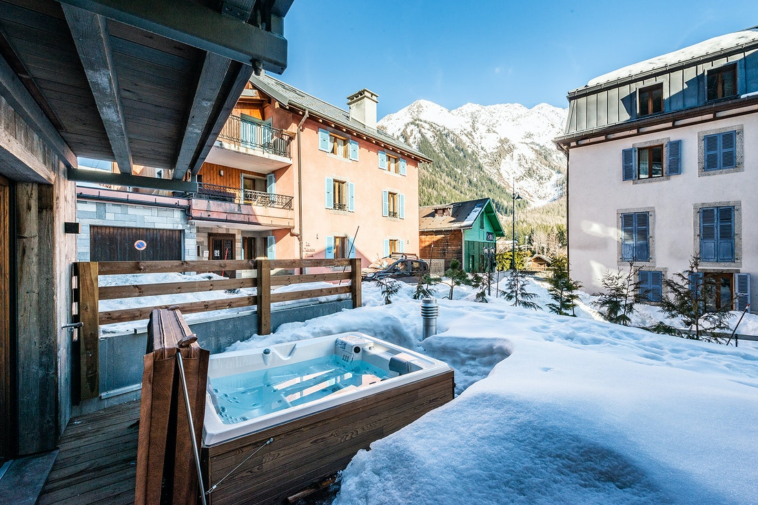 Private wooden hot tub with mountain views at Douka accommodation in Morzine